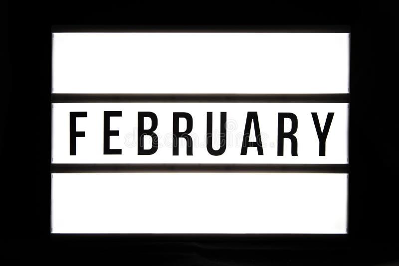 FEBRUAR-Text in einem Leuchtkasten lizenzfreie stockfotos