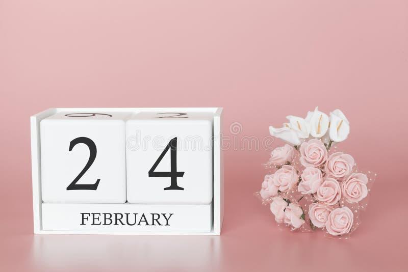 24 februari Dag 24 van maand Kalenderkubus op moderne roze achtergrond, concept zaken en een belangrijke gebeurtenis royalty-vrije stock fotografie