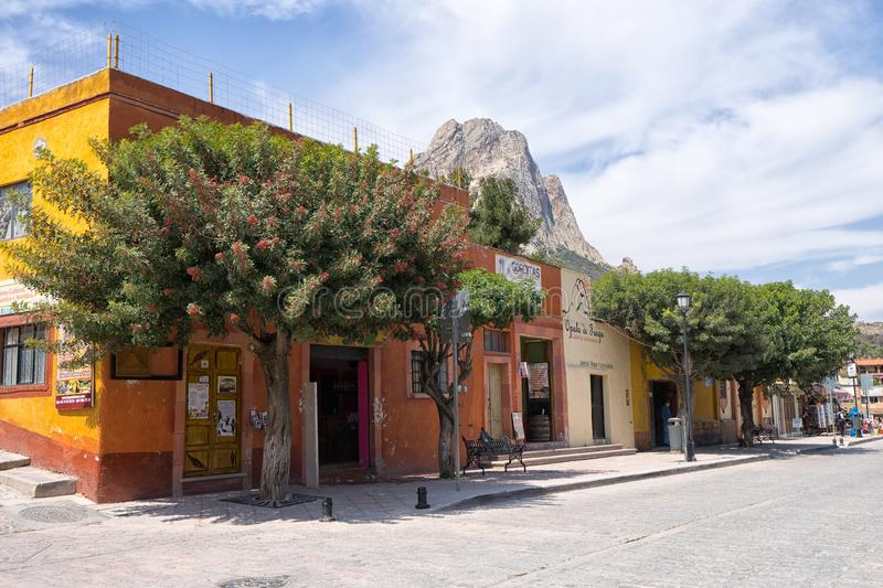 Street view of Bernal, Queretaro, Mexico. February 26, 2016 Bernal, Queretaro, Mexico: street view of the popular tourist town with the peak of the large stock image