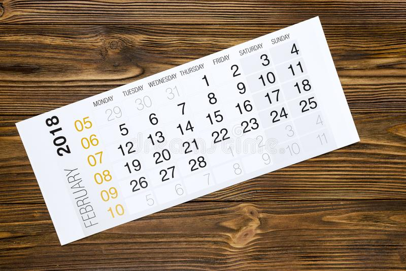 February 2018 calendar on wooden table stock photo