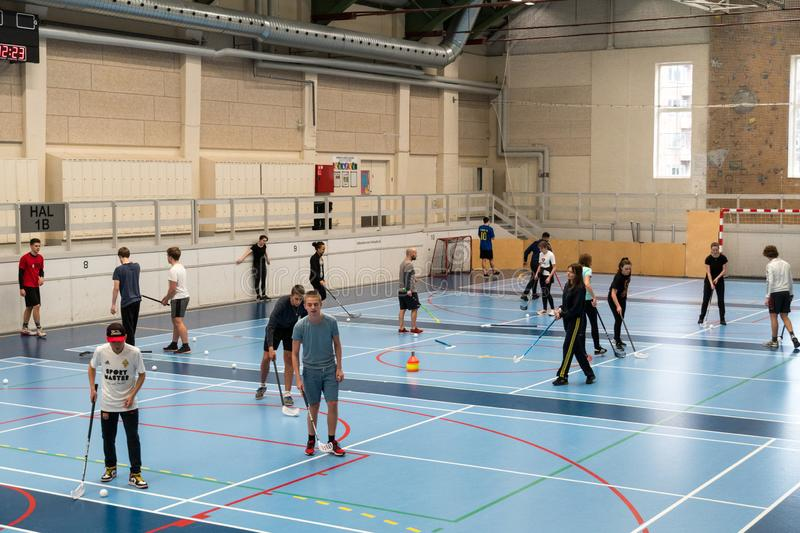 February 21, 2019. Denmark. Copenhagen. Team game with stick and ball Floorball or hockey in hall. Inside training in the gym of. The school college. Group of royalty free stock photos