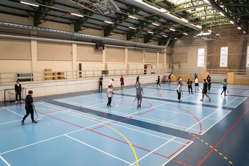 February 21, 2019. Denmark. Copenhagen. Team game with stick and ball Floorball or hockey in hall. Inside training in the gym of. The school college. Group of royalty free stock images