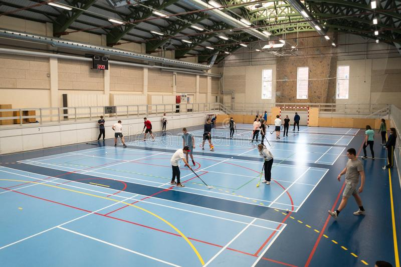 February 21, 2019. Denmark. Copenhagen. Team game with stick and ball Floorball or hockey in hall. Inside training in the gym of stock photo