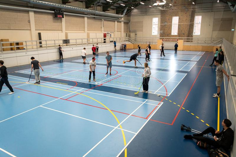 February 21, 2019. Denmark. Copenhagen. Team game with stick and ball Floorball or hockey in hall. Inside training in the gym of. The school college. Group of royalty free stock photo