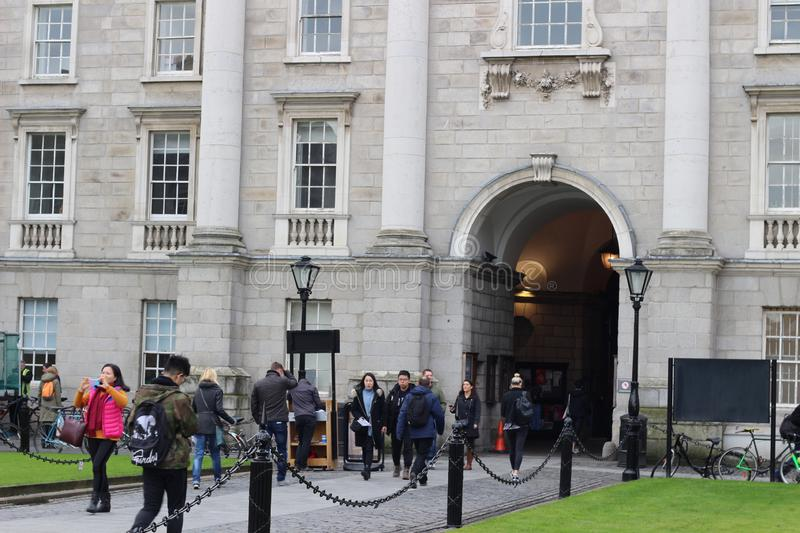 February 18 2018, Dublin Ireland: Editorial photograph of students congregating around the entrance of Trinity stock image