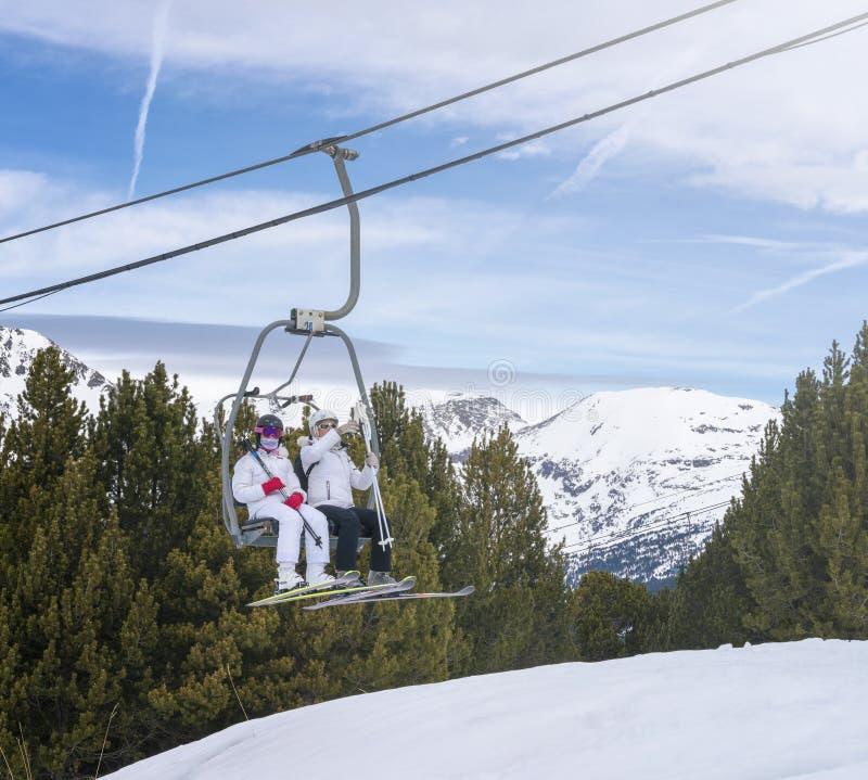 Skiers in Ski Resort Transportation Chairlift royalty free stock image