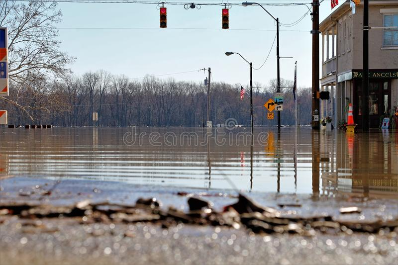 Flooded waters in Aurora, Indiana. February 2018 flooding of Aurora, Indiana from the Ohio River. ground view. low angle view royalty free stock photo