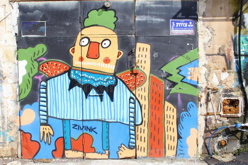 February 2019, funny big fat man street art walls, Florentin quarter, Tel Aviv. Funny giant  man and modern flat buildings at a mural wall painting in outdoor stock photography
