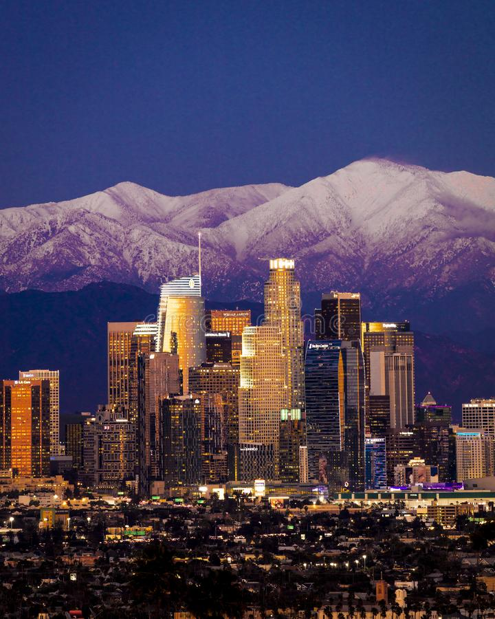 FEBRUARY 6, 2019 - LOS ANGELES, CA, USA - City of Angeles - Los Angeles Skyline framed by San Bernadino Mountains and Mount Bald. Y with fresh snow from Kenneth stock photo