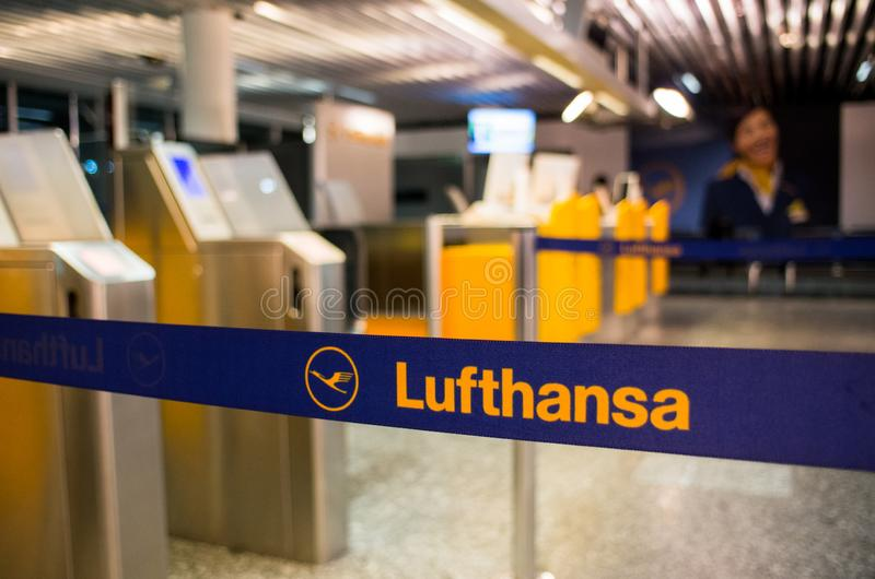 Lufthansa logo at the check-in counters at the airport royalty free stock photos