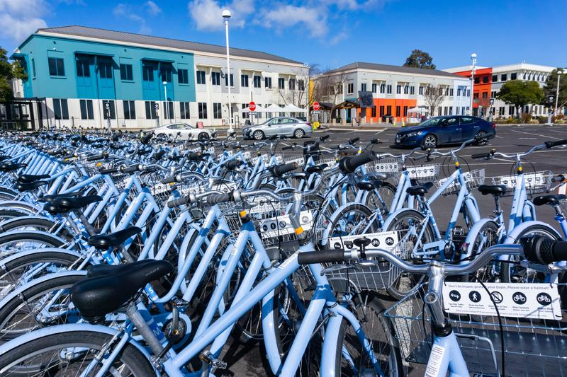 February 10, 2019 Menlo Park / CA / USA - Bicycles parked in front of the Facebook`s main campus in Silicon Valley, San Francisc. O bay area royalty free stock photography