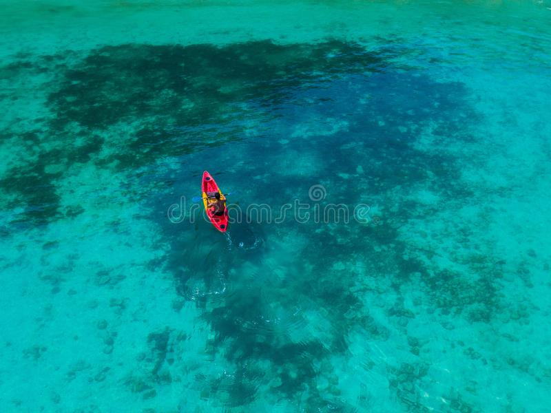25 February 2019-Myanmar::tourist kayaking on clear water at Horse shoe island. Kayak stock photo