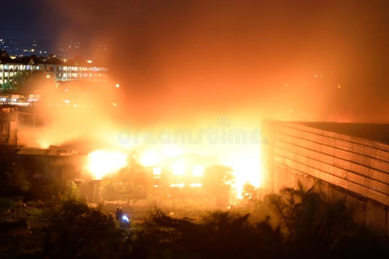 February 20 2018 7:20pm Fire in Pasig Philippines. An electrical transformer exploding while it got hit by the massive fire in Rosario Pasig Philippines royalty free stock photo
