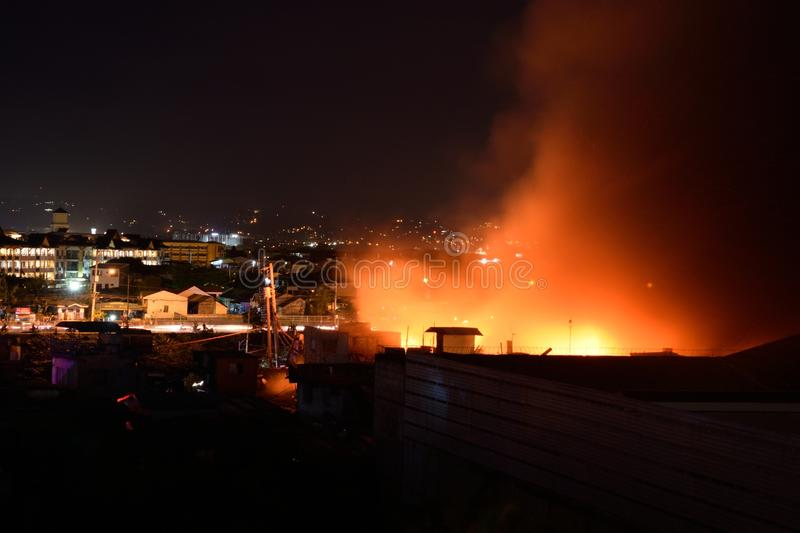 February 20 2018 7:20pm Fire in Pasig Philippines. A massive fire in Rosario Pasig Philippines that burned a warehouse and houses during the night stock photo