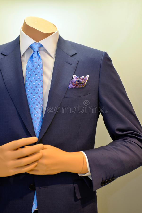 Clothing Business, Classic Suit Coat and Blue Pattern Tie, Pocket Scarf, Man Clothes royalty free stock image