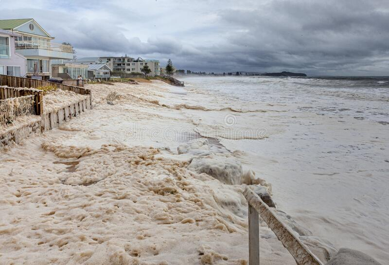 Beach Erosion and Sea Foam on Sydney`s Northern Beaches royalty free stock image
