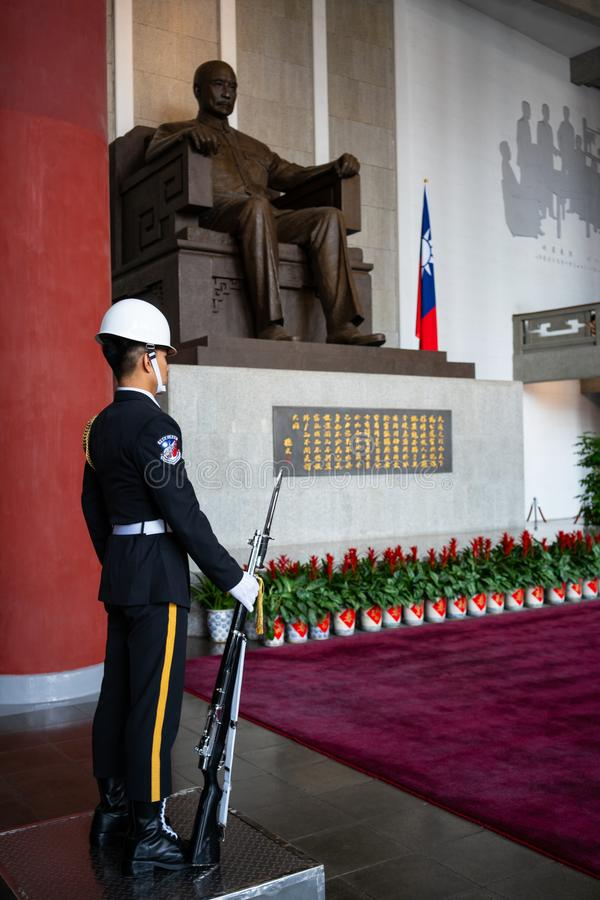 Honor guard with rifle and bayonet in front of statue of Sun Yat Sen at Sun Yat-Sen memorial hall in Taipei Taiwan stock photo