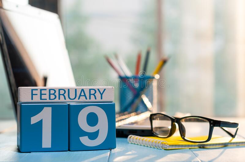 February 19th. Day 19 of month, calendar on auditor workplace background. Winter time. Empty space for text.  stock photo