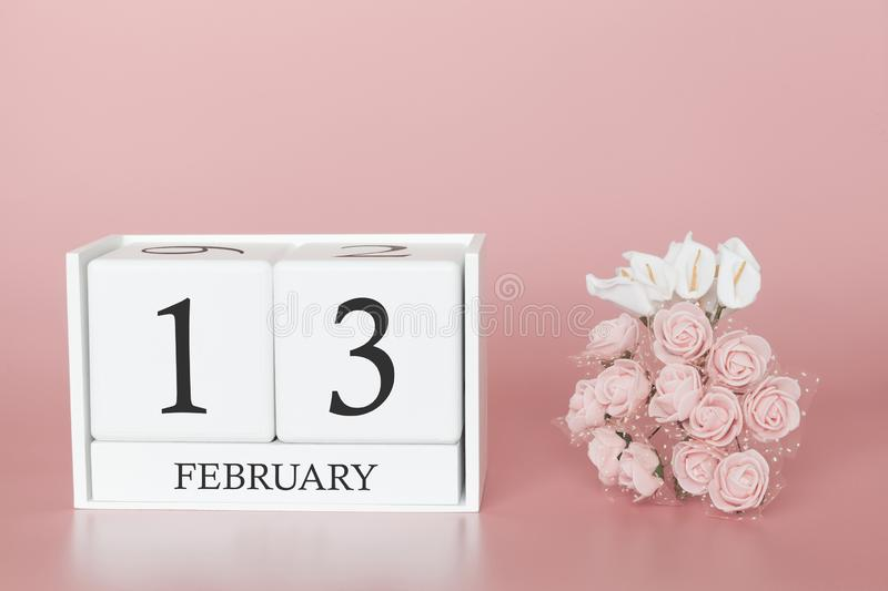February 13th. Day 13 of month. Calendar cube on modern pink background, concept of bussines and an importent event royalty free stock images