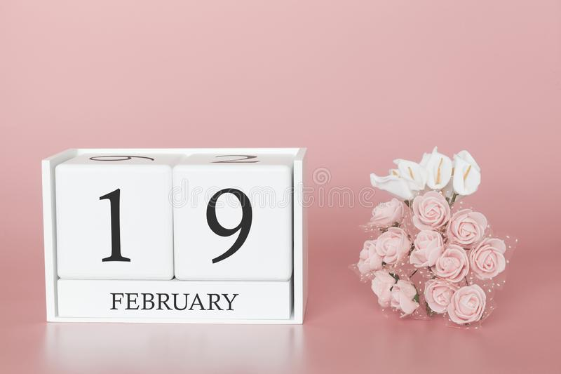 February 19th. Day 19 of month. Calendar cube on modern pink background, concept of bussines and an importent event stock image