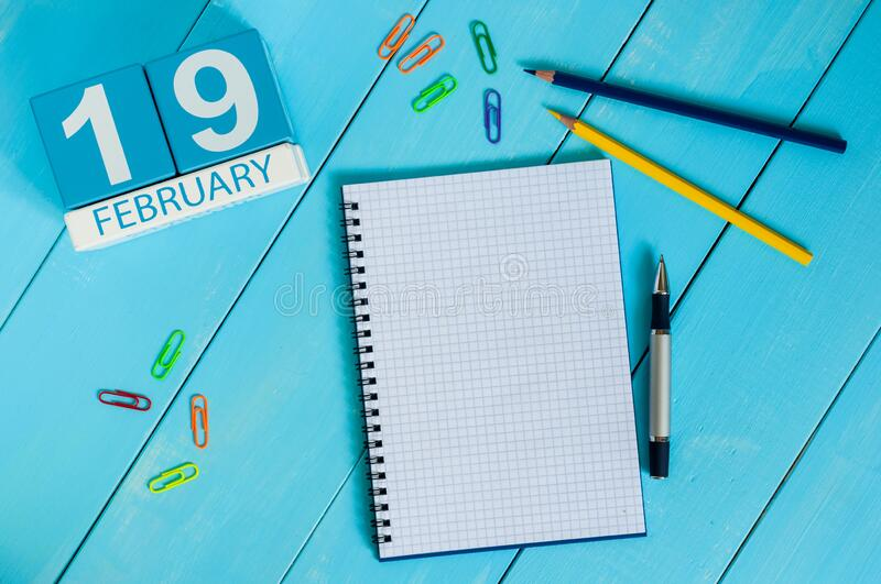 February 19th. Day 19 of month, calendar on wooden background. Winter time. Empty space for text.  royalty free stock photography