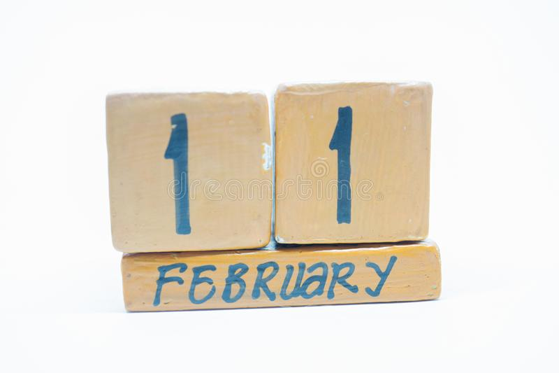 February 11th. Day 11 of month, handmade wood calendar isolated on white background. Winter month, day of the year concept. February 11th. Day 11 of month stock images