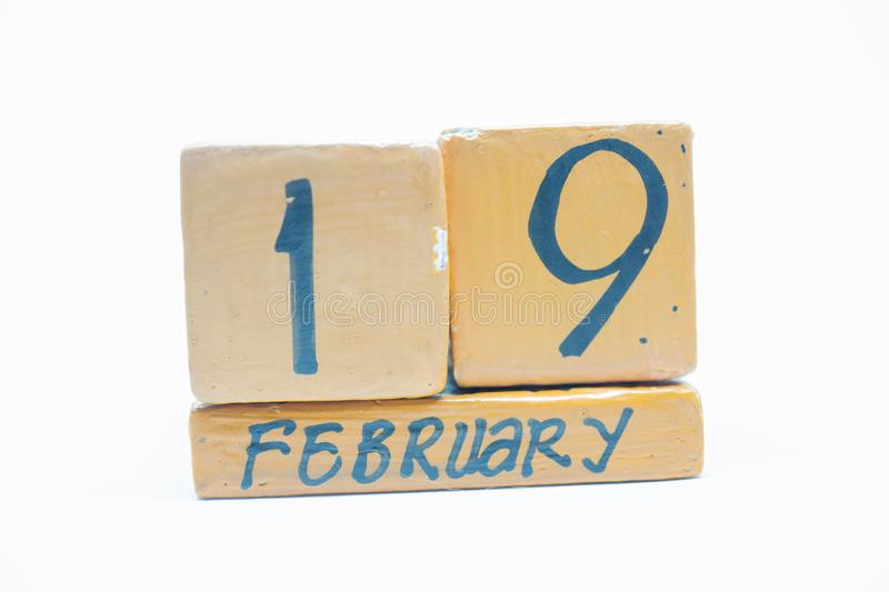 February 19th. Day 19 of month, handmade wood calendar isolated on white background. Winter month, day of the year concept. February 19th. Day 19 of month royalty free stock image