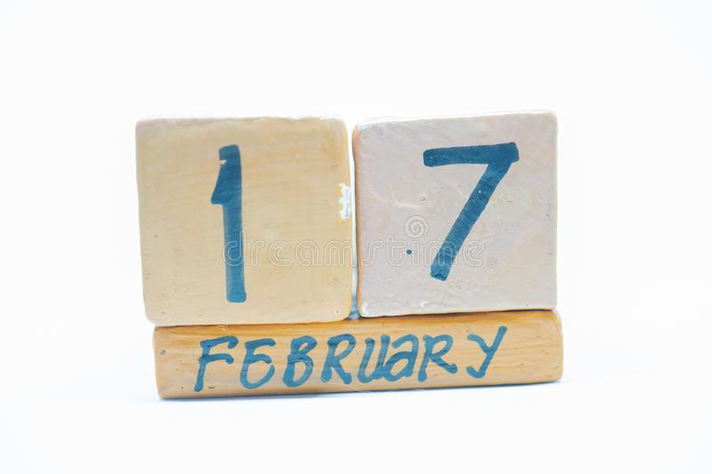 February 17th. Day 17 of month, handmade wood calendar isolated on white background. Winter month, day of the year concept. February 17th. Day 17 of month stock photos