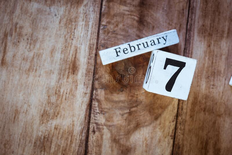 February 7th. Day 7 of February month, white calendar blocks on vintage wooden table background. Winter time. Empty space for text stock images