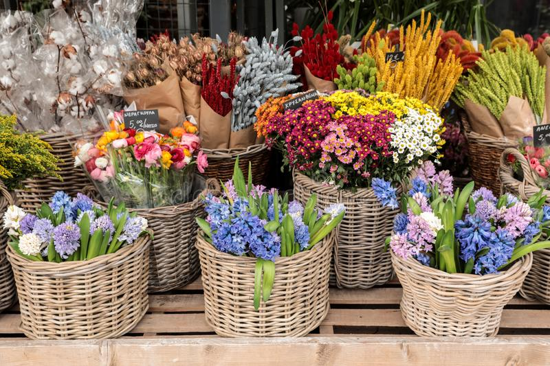 February 12th, 2019. Everyday flowers counter with variety of fresh cut flowers such as hyacinths, persian buttercups, royalty free stock image