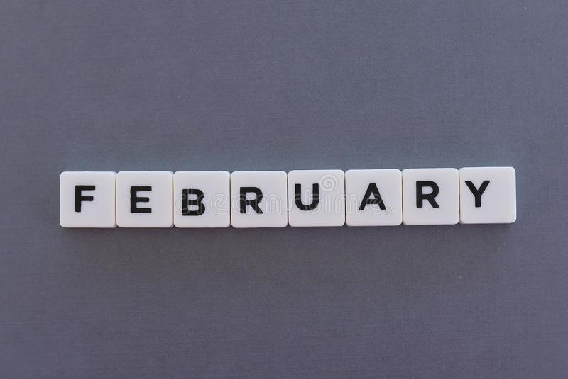 February word made of square letter word on grey background. Month time day date monthly calendar concept text winter reminder design number hello diary holiday royalty free stock images