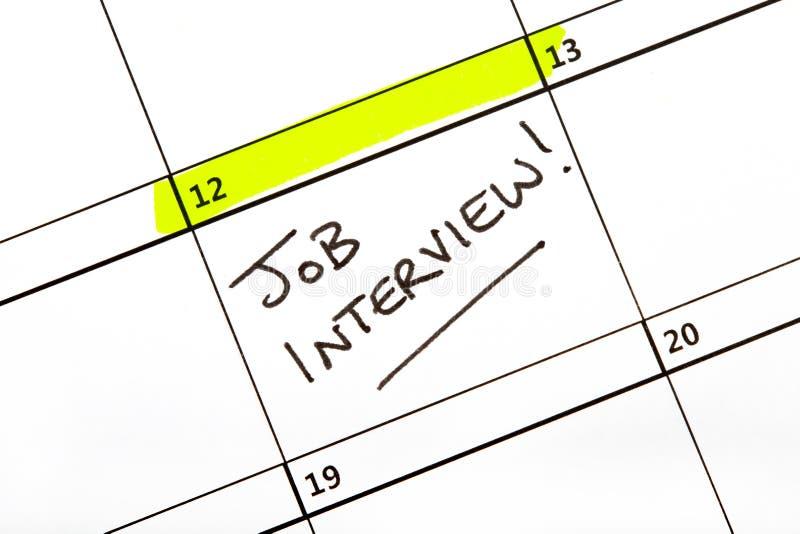 Fecha de la entrevista de trabajo en un calendario foto de archivo