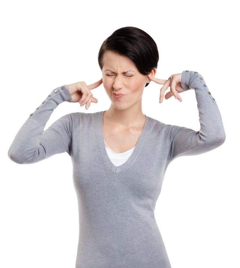 Fechar as orelhas com mulher dos dedos parafusa acima seus olhos fotos de stock royalty free