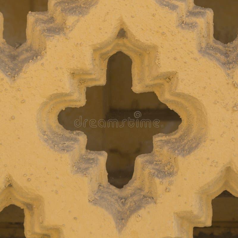 Feche acima, cerca concreta do amarelo, fundo arquitetónico textured fotografia de stock
