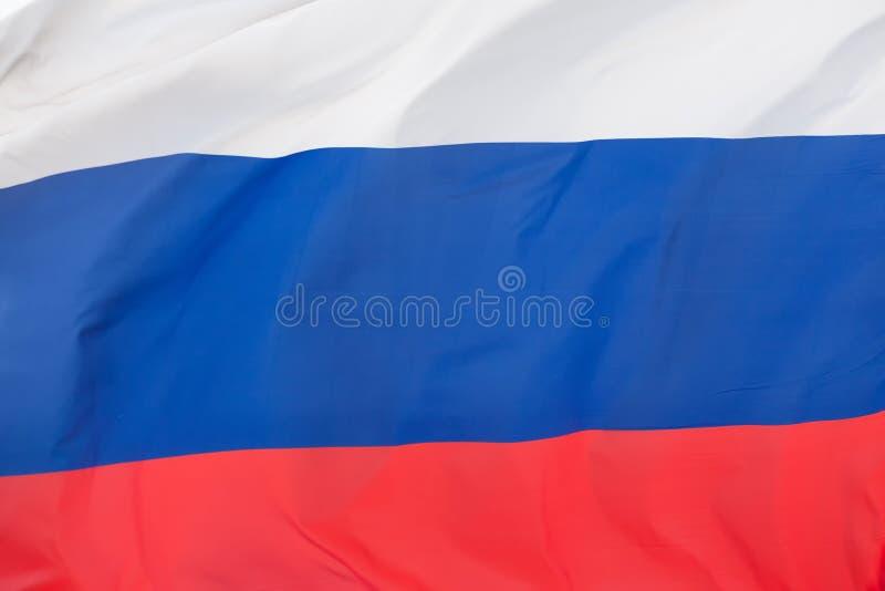 Feche acima da bandeira do russo fotografia de stock