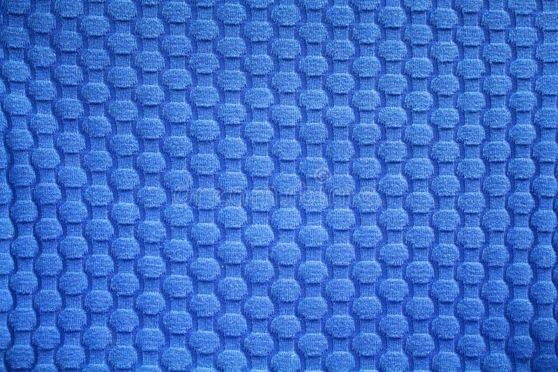 Feche acima da ideia do fundo azul da tela/matéria têxtil fotos de stock