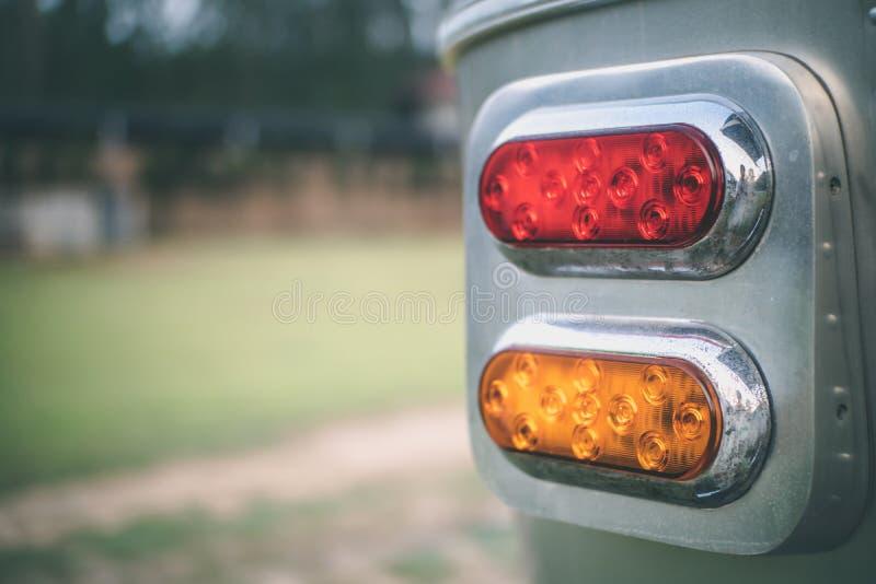 Feche acima da lanterna traseira clássica vermelha e amarela fotografia de stock royalty free
