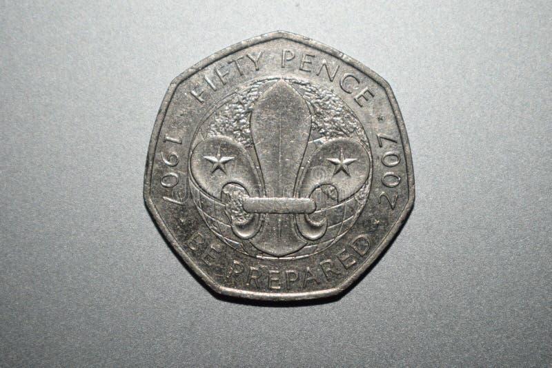 Feche acima da moeda com fundo de prata fotografia de stock
