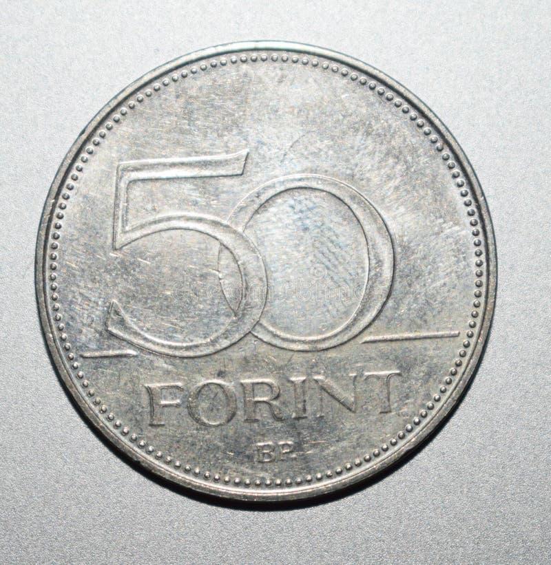 Feche acima da moeda com fundo de prata imagens de stock royalty free