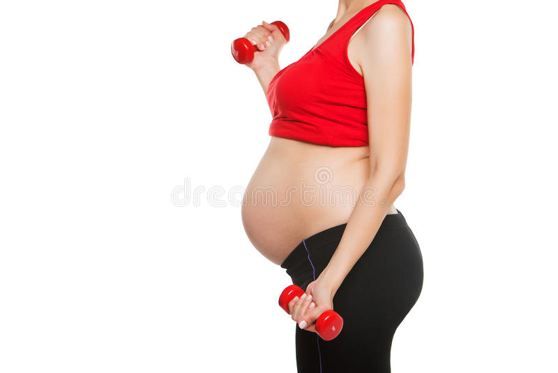 Feche acima da mulher gravida feliz exercitam, fotografia de stock royalty free