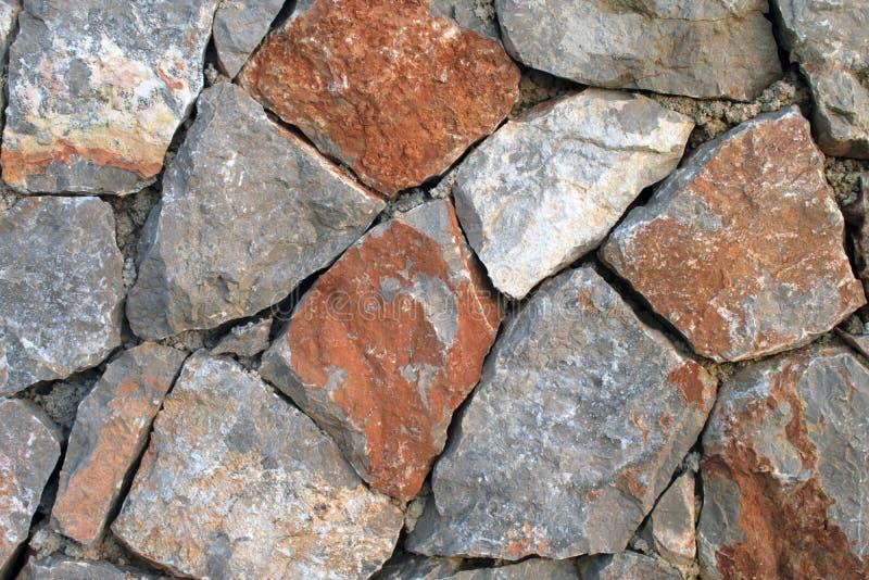 Feche acima da parede de pedra fotos de stock royalty free