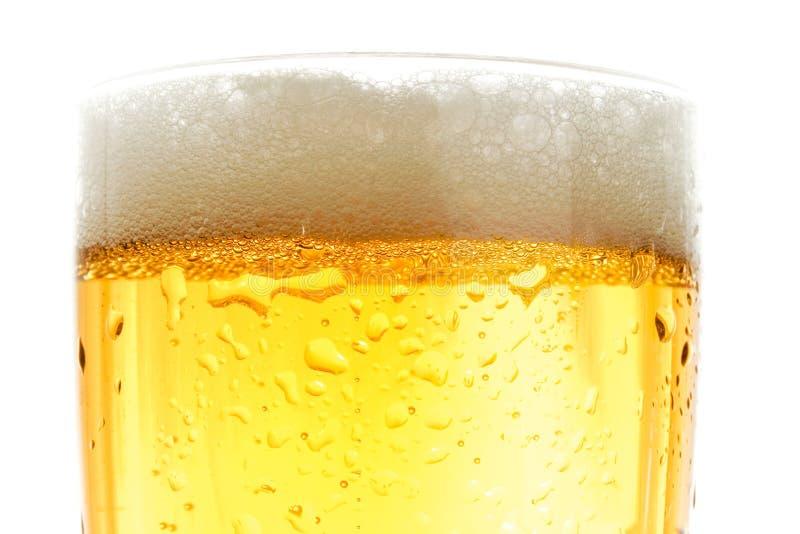 Feche acima da pinta da cerveja imagem de stock