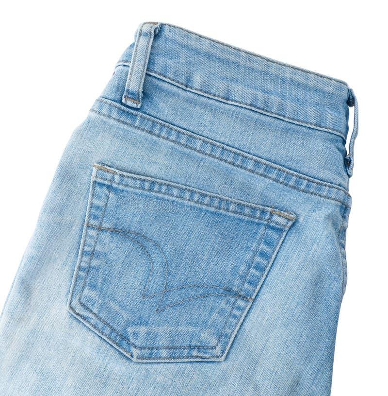Feche acima da sarja de Nimes azul Jean no fundo branco fotos de stock royalty free