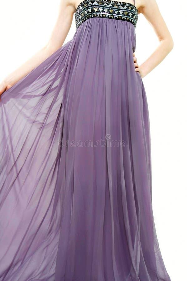 Feche acima da senhora nova no vestido roxo longo fotografia de stock royalty free
