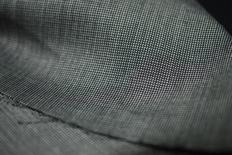 Feche acima da tela cinzenta do teste padrão do terno imagens de stock royalty free