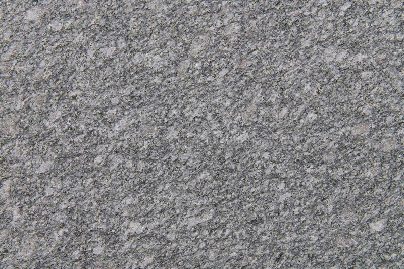 Feche acima da textura sem emenda cinzenta do granito decorativa imagem de stock