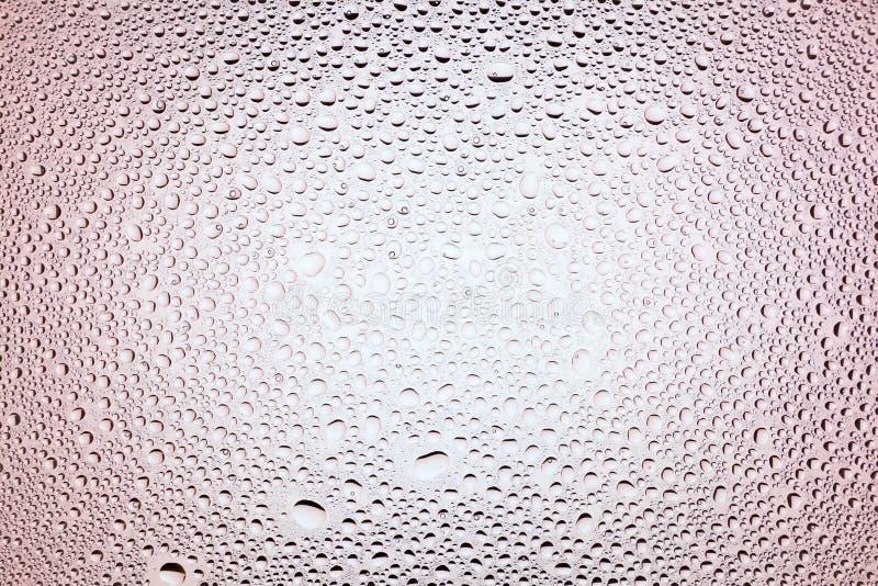 Feche acima das gotas de uma água foto de stock