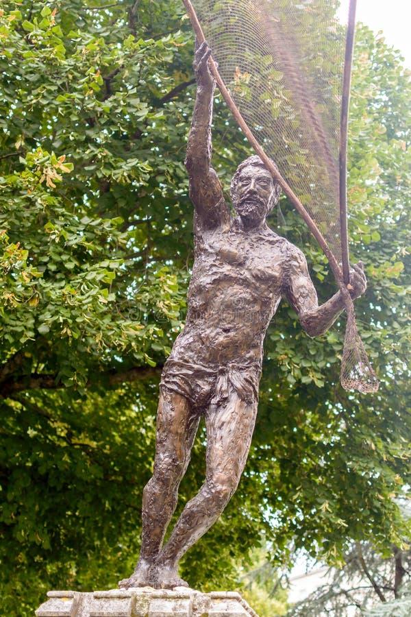 Feche acima de Andrew The Fisherman Sculpture por Rodney Munday imagem de stock