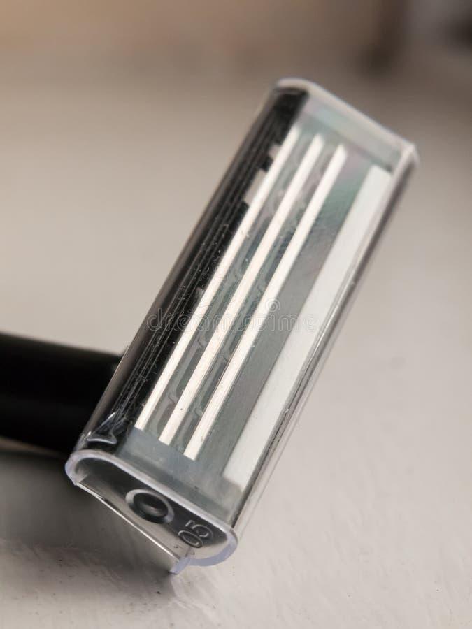 Feche acima de coberta não utilizada do calor plástico masculino da lâmina fotos de stock royalty free