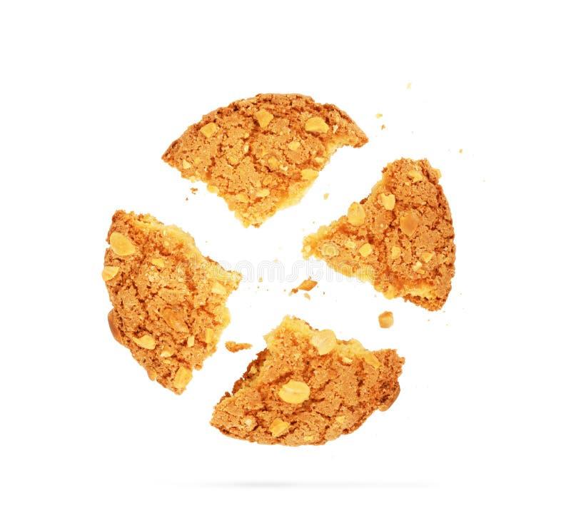 Feche acima de uma cookie comida metade com migalha imagem de stock